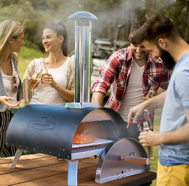 making pizza outdoors with friends in pizza oven