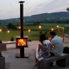 The Garden Cube Outdoor Stove Flames at night