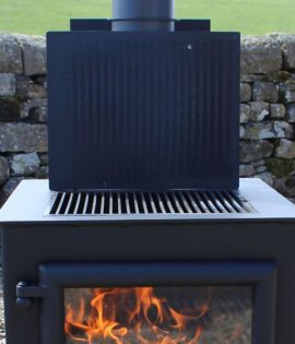 bbq stove outdoors with grill plate up