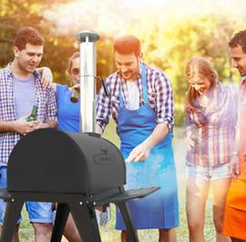 friends enjoying outdoor pizza oven